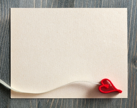 Background for design with a leaf of paper for notes and red decorative heart Stock Photo - 17635087