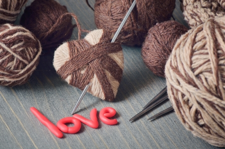 Still life of balls of yarn and the word love photo