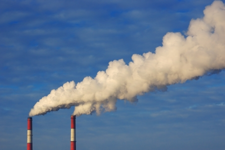 emissions: Pollution  Smoke from industrial chimneys against the blue sky