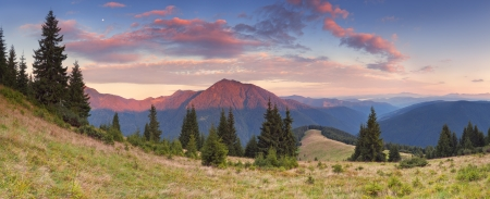 Beautiful sunrise in the mountains  Panorama photo