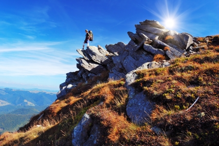 Summer mountain landscape with tourist on cliff Stock Photo - 18871884