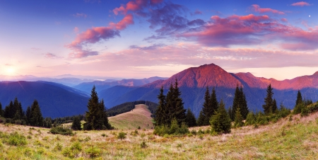 Beautiful sunrise in the mountains  Panorama of a mountain valley on a summer morning Archivio Fotografico