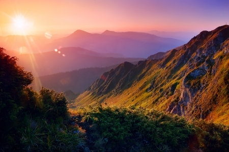 Beautiful summer landscape in the mountains with the sun at dawn photo