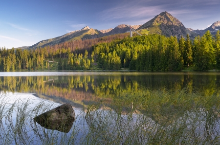 Summer landscape with a beautiful lake in the mountains  Slovakia, lake Strbske Pleso photo