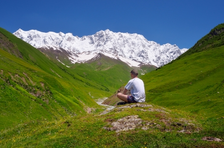Summer landscape with tourist in the mountains of the Caucasus  Shkhara Mountain, Georgia, Caucasus