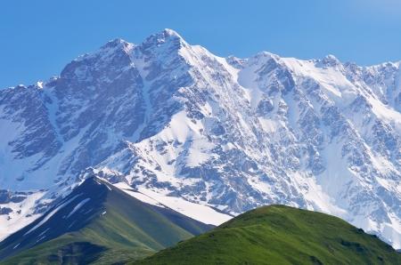 shkhara: Mountain landscape with snow-covered peak  Shkhara Mountain, Georgia, Greater Caucasus Range Stock Photo