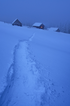 Night landscape with a footpath to a mountain hut in the snow  Ukraine, Carpathian mountains, the valley Kukul photo