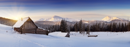 cold weather: Panorama of winter mountains with houses of shepherds  Carpathians, Ukraine, Europe