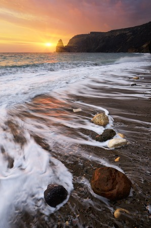 Sea coast at sunset  Beautiful waves on the beach  Crimea, Ukraine, Europe  photo