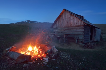 Night near the mountain hut  Big fire on tourist parking lot near the house of the shepherds  Carpathians, Ukraine, Europe photo
