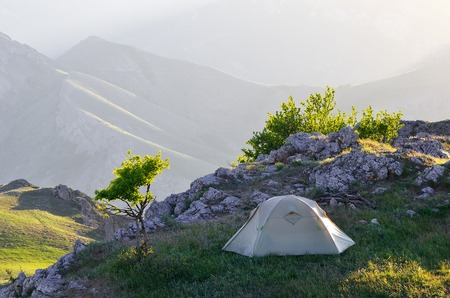 Morning landscape with a tent  Camping in the Spring Mountains photo