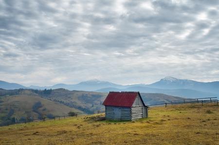 Autumn landscape overcast day  Wooden hut in a mountain village  Carpathians, Ukraine, Europe