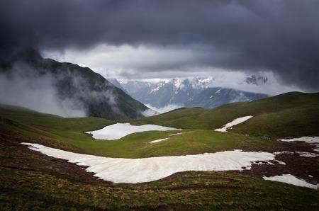 Koruldi mountain lake under the stormy sky  Georgia, Svaneti photo