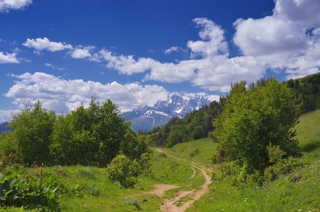 svan: Summer landscape sunny day  Road in the mountains  Svaneti, Georgia, Caucasus  View of Mount Ushba Stock Photo