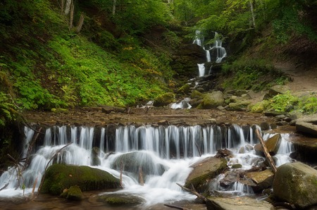 beech wood: Forest landscape with beautiful waterfall on a mountain river  Cascades cold stream  Beech forest  Carpathians, Ukraine, Europe Stock Photo