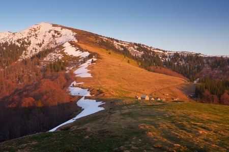 ramshackle: Evening landscape with mountain village of shepherds  Spring in the mountains  Light of the setting sun  Carpathians, Ukraine, Europe