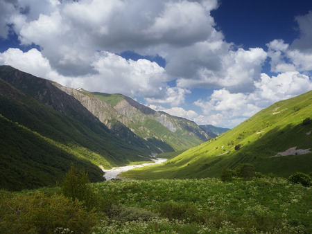 Summer landscape with river in a mountain valley  View from the beautiful sky above the mountains  Zemo Svanetii, Georgia, Caucasus photo