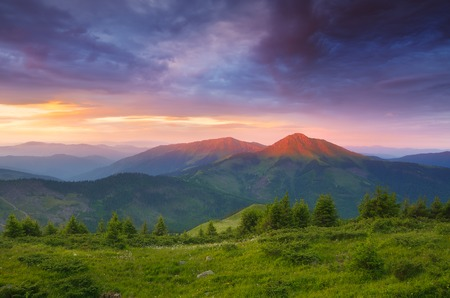 Summer landscape with colorful morning  The first rays of the sun on the mountain tops  Romanian Carpathians photo