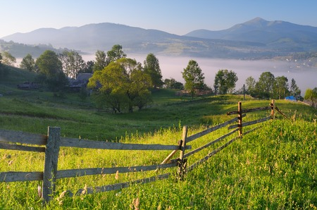 Summer landscape  Morning in a mountain village photo