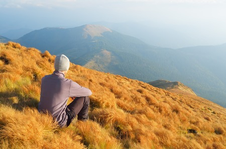 Autumn Landscape with a man sitting on the hillside  Outdoor recreation photo