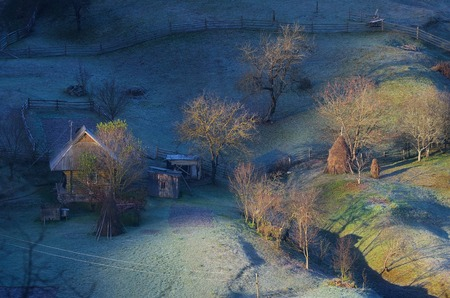 homestead: Autumn landscape. Farmstead with wooden houses. Morning with frost. Carpathian mountains, Ukraine, Europe