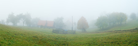 dampness: Rural landscape with fog. Autumn in the mountains. Panoramic view of the yard garden. Carpathians, Ukraine, Europe