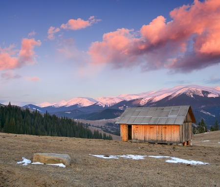 wooden houses: Spring landscape with small wooden house for hay. Carpathian mountains, Ukraine, Europe Stock Photo