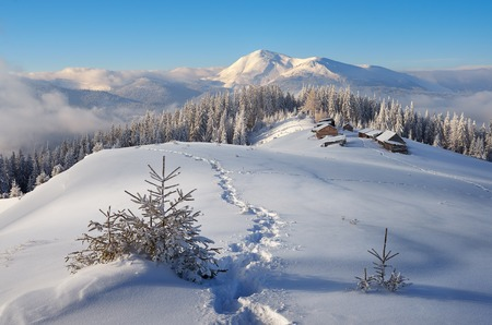 mountain hut: Trail to the mountain huts. Winter is in a fabulous location. Mountains Carpathians, Ukraine, Europe. Christmas landscape Stock Photo