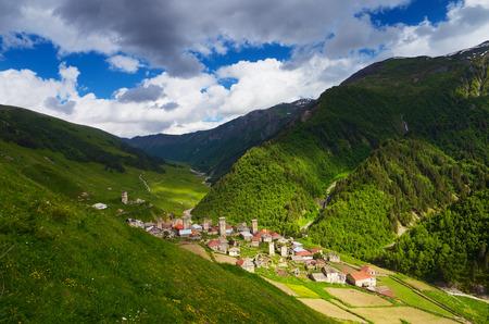 svan: Summer landscape. The traditional mountain village. Old houses made of stone. Main Caucasian ridge. Zemo Svaneti, Georgia