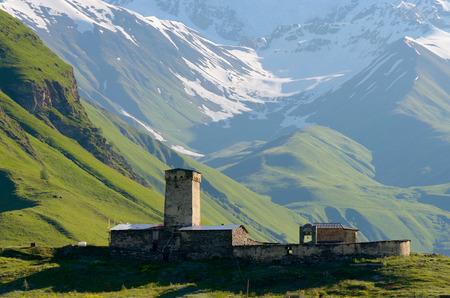 svan: Stone medieval church in a mountain valley. View of Mount Shhara. Ushguli community, Zemo Svaneti, Georgia Stock Photo