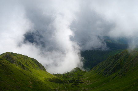 Summer landscape. Beautiful clouds in the mountains. Interesting in nature. Carpathians, Ukraine, Europe photo