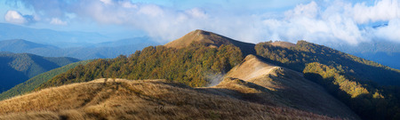 Autumn landscape. Mountain panorama. Forest on the slopes photo