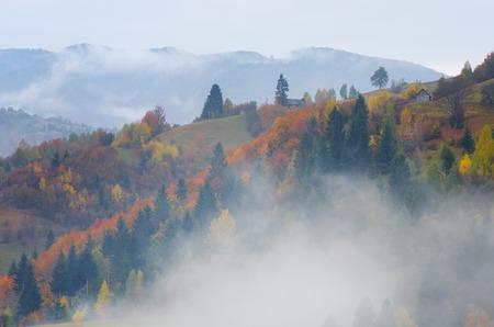 ramshackle: Fog in the mountain village. Autumn landscape Stock Photo