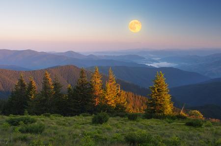 moon light: Mountain landscape. Morning light. The full moon. Beauty in nature Stock Photo
