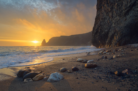 Seascape with sunset. Evening by the sea. Beautiful rock on the shore. Crimea Archivio Fotografico