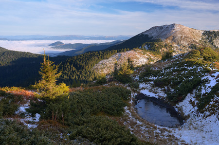 nature beauty: Autumn landscape with the first snow. Frozen lake in the mountains. Beauty in nature. Carpathians, Ukraine, Europe