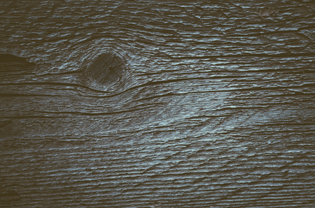 wooden color: Old wooden board with knots and cracks. Texture for design. Color toning. Low contrast Stock Photo