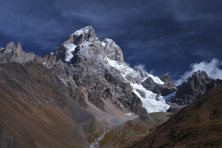 svaneti: Mountain landscape with the top of Ushba. A sunny autumn day. Main Caucasian ridge. Zemo Svaneti, Georgia Stock Photo