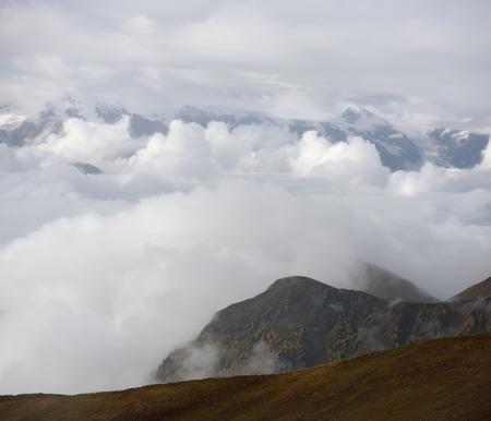 svan: Clouds in the mountains. Autumn landscape. Zemo Svaneti, Georgia. View on Svan range with lakes Koruldi