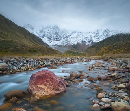 shkhara: Mountain landscape. River Valley. The highest mountain of Georgia - Shkhara. Main Caucasian ridge. Zemo Svaneti, Georgia