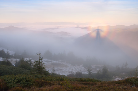 gloria: Autumn landscape. Mountain ghost in the fog. Beauty in nature. Phenomenon of Gloria. Carpathians, Ukraine, Europe Stock Photo