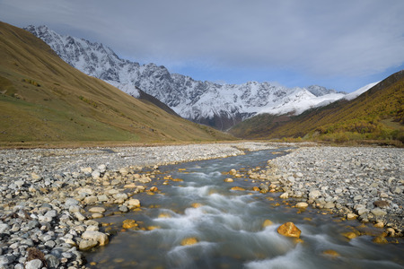 shkhara: Mountain river. Autumn landscape. Snowy mountain peak. Enguri River and Mount Shkhara. Caucasus, Georgia, Zemo Svaneti Stock Photo
