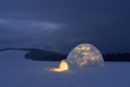 igloo: Night landscape. Snow igloo in mountains. Extreme housing for tourists Stock Photo