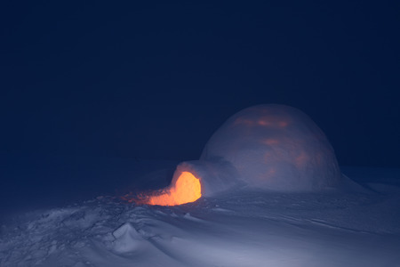igloo: Snow igloo with light. Night in mountains. Adventure tour. House for tourists
