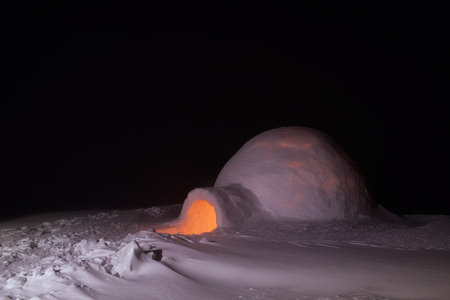 snow house: Night in mountains. Extreme snow house. Snow igloo
