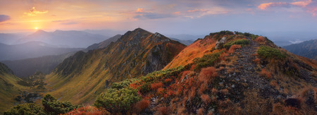 sunrise mountain: Mountain panorama at sunrise. Path to top. Autumn landscape. Carpathians, Ukraine, Europe Stock Photo