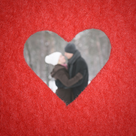 couples hug: Hole in shape of heart. Story is Valentines Day. A loving couple in defocusing