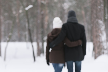 photo story: Happy couple in arms of walks in nature. Love story. Photo in defocusing