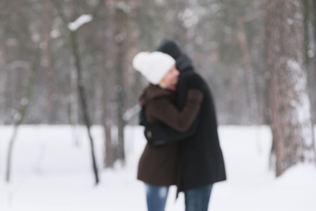 photo story: Love story. Happy couple in an embrace. Walk in park. Photo in defocusing