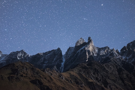 caucas: Night landscape. Mountain top and the starry sky. Moonlight on the rocks. Beauty in nature. Caucasus, Georgia, Zemo Svaneti Stock Photo